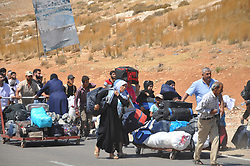 August 21, 2017 - Hatay, Türkiye - Thousands of Syrian refugees that has been living in Turkey is going to their Country for a Kurban Bayram Fest visit. Syrians are passing the Turkish-Syrian border from Cilvegozu Border Gate near Hatay region of Turkey. Last year it is announced that 35.000 Syrians of 120.000 came back to Turkey after Ramadan Bayram Fest. (Credit Image: © Depo Photos via ZUMA Wire)