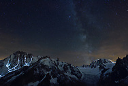 Light trails of climbers and the milky way over Mont Blanc, Chamoinx, France, composed <br /> <br /> Impressionen beim Refuge du Couvercle am Fuss der Aiguille Verte über dem Mer de Glace an einem sehr schönen Herbsttag im September
