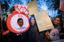 6 December 2019, Madrid, Spain: A woman dressed in a giant alarm bell suit 'sounds the alarm for climate justice' together with people carrying placards reading 'Climate justice in intergenerational justice' and 'God saw everything that God had made, and indeed, it was very good', as faith-based participants from the Lutheran World Federation, the World Council of Churches and the ACT Alliance join in as thousands upon thousands of people march through the streets of central Madrid as part of a public contribution to the United Nations climate meeting COP25, urging decision-makers to take action for climate justice.