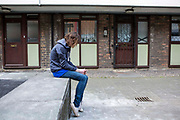 A vulnerable teenage youth hanging about on a Hackney estate, London. UK