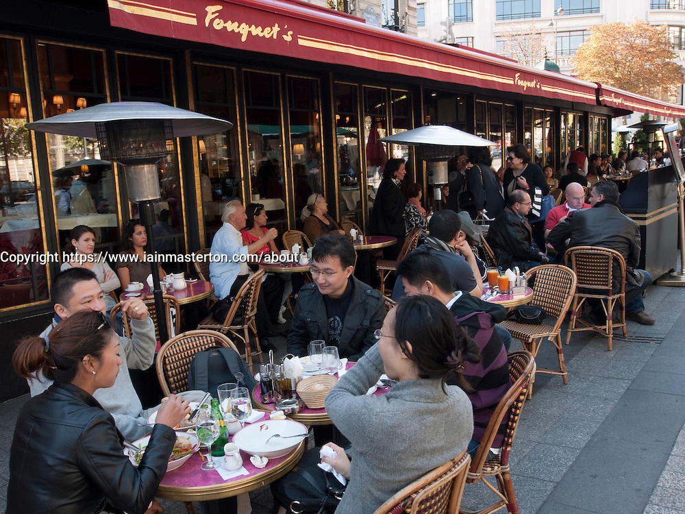 Tourists easting at Fouquet's restaurant on the Champs Elysees in Paris France