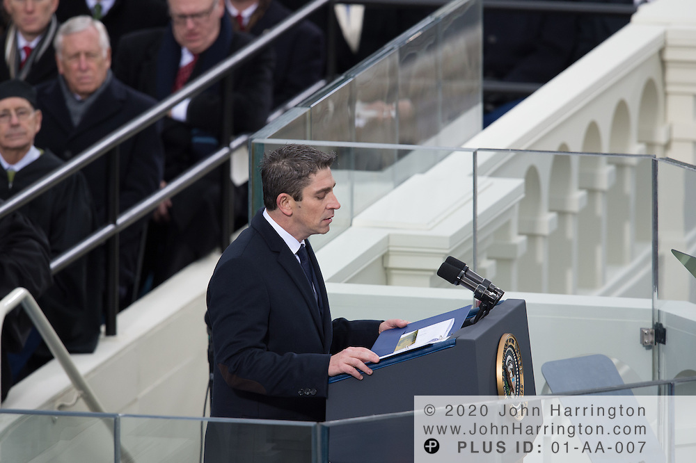 Poet Richard Blano presents his inauguration poem during the 57th Presidential Inauguration of President Barack Obama at the U.S. Capitol Building in Washington, DC January 21, 2013.