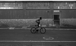 Cycling through Woodstock, Cape Town