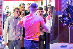 "© Licensed to London News Pictures . 24/12/2016 . Manchester , UK . A fight breaks out inside a takeaway on Withy Grove . Revellers out in Manchester City Centre overnight during 2016's second "" Mad Friday "" , named for historically being one of the busiest nights of the year for the emergency services in the UK . Photo credit : Joel Goodman/LNP"