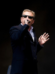 "© Licensed to London News Pictures. 27/08/2011. Reading, UK. Madness play the main stage on day two of Reading Festival 2011 in Reading, Berkshire today (27/08/2011). Pictured is lead singer Graham ""Suggs"" McPherson Photo credit: Ben Cawthra/LNP"