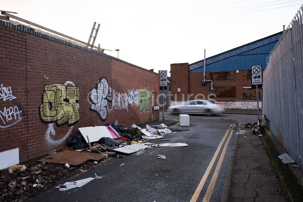 Fly tipped waste on the street on an industrial estate in Deritend close to the city centre on 14th December 2020 in Birmingham, United Kingdom. Illegal dumping, also called fly dumping or fly tipping, is the dumping of waste illegally instead of using an authorised method such as kerbside collection or using an authorised rubbish dump. It is the illegal deposit of any waste onto land, including waste dumped or tipped on a site with no licence to accept waste.