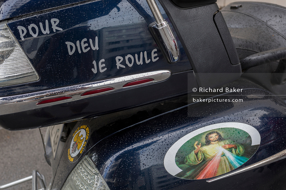 Detail of a French Harley-Davidson motorbike belonging to a bike club with the words 'Pour Dieu Je Roule' (I ride for God) in the Slovenian capital, Ljubljana, on 28th June 2018, in Ljubljana, Slovenia.