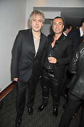 Left to right, NICK RHODES and JULIEN MACDONALD at a dinner hosted by Ruinart Champagne for Yasmin Mills at Nobu, Park Lane, London on rth May 2009.