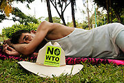 12 SEPTEMBER 2003 - CANCUN, QUINTANA ROO, MEXICO:  A Mexican farmer sleeps in a park in Cancun during a break between anti-globalization protests Friday. Thousands of anti-globalization protestors have come to Cancun to try to disrupt the 5th Ministerial of the World Trade Organization. The protestors have been restricted to the area in downtown Cancun, while the WTO is meeting 10 miles away in the Cancun tourist zone. PHOTO BY JACK KURTZ