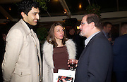Salman Rushdie and friends at Party after the opening of Salman Rushdie's 'Midnight's Children'  Bombay Brasserie. 28 January 2003. © Copyright Photograph by Dafydd Jones 66 Stockwell Park Rd. London SW9 0DA Tel 020 7733 0108 www.dafjones.com