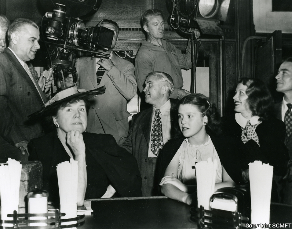 9/12/1946 Ellen Drew (at right) at a party at Schwab's Pharmacy