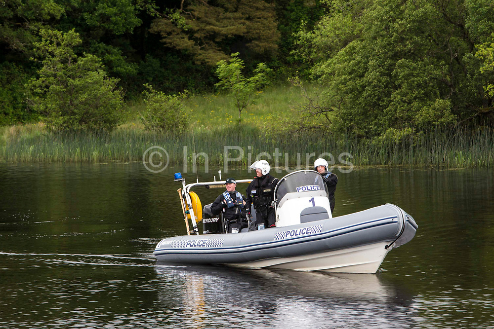 Policemen boat patrol Lough Erne in Country Fermanagh, Northern Ireland as it hosted the 39th G8 summit on 17th June 2013. There was high security levels as the leaders of the eight of the world's largest national economies gathered to discuss tax evasion and transparency and the Syrian civil war.