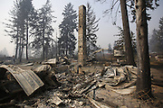 A chimney is the only thing that still stands after a wildfire swept through the community on White Rock Road, destroying several houses, in Okanogan Sunday, August 23, 2015.<br /> <br /> Sy Bean / The Seattle Times