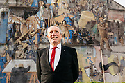 Labour candidate Gordon Munro stands infront of a mural to the works of Leith.
