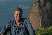 Pete Oxford on Sugar Loaf, Rio de Janeiro, BRAZIL, South America<br /> The summit of Rio's unique 1,299ft high (396m) mountain can be reached by a two-stage cable car ride. <br /> The Tijuca Forest, part of the Atlantic Rain Forest is the largest Urban forest in the world.