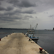 View of a docked fishing boat in a pier in Togura, Miyagi prefecture. Since the 2011's tsunami that struck over the coastal areas of Japan, the fishing community of Togura, devastated by the natural disaster, formed a cooperative where all the families work together using the only two remaining boats in the whole village.