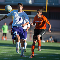092514     Cayla Nimmo<br /> <br /> Miyamura Patriot Dominic DePauli (18) and Gallup Bengal Anthony Olivares (11) fight for control of the ball during the game at the Public School Stadium in Gallup Thursday.