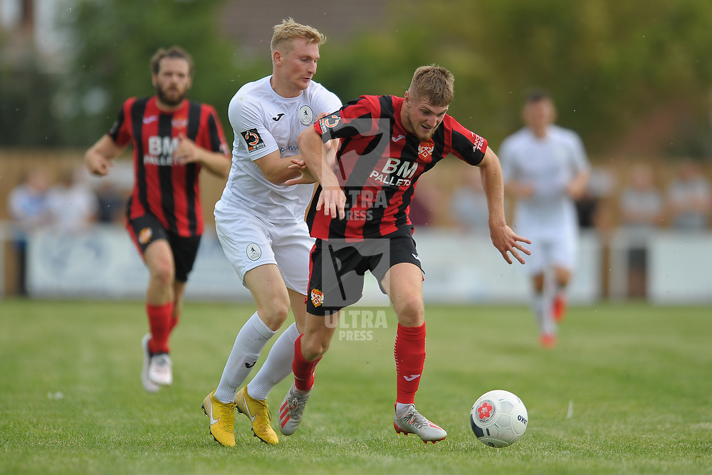 TELFORD COPYRIGHT MIKE SHERIDAN Chris Lait battles with Connor Kennedy during the National League North fixture between Kettering Town and AFC Telford United at Latimer Park on Saturday, August 3, 2019<br /> <br /> Picture credit: Mike Sheridan<br /> <br /> MS201920-005