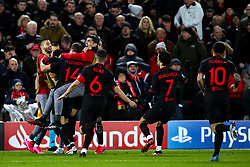 Marcos Llorente of Atletico Madrid celebrates with teammates after scoring a goal to make it 2-1 (2-2 agg) - Mandatory by-line: Robbie Stephenson/JMP - 11/03/2020 - FOOTBALL - Anfield - Liverpool, England - Liverpool v Atletico Madrid - UEFA Champions League Round of 16, 2nd Leg