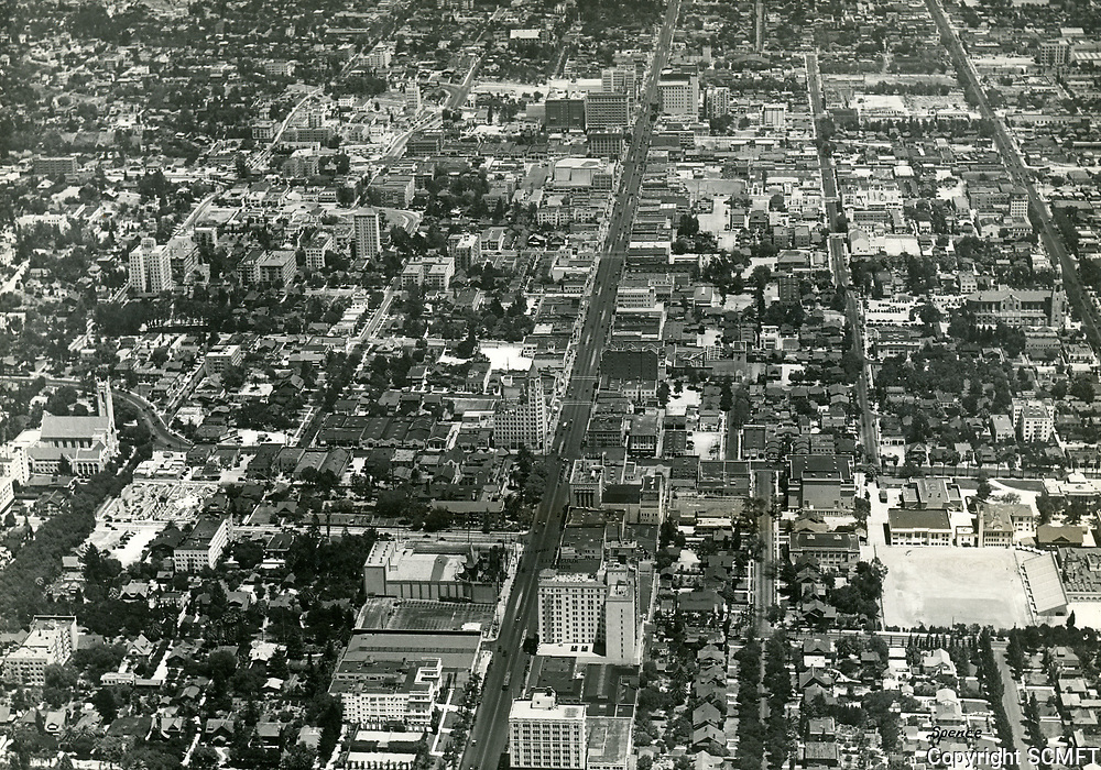 1932 Looking east down Hollywood Blvd. near Highland Ave.