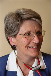 Portrait of doctor wearing stethoscope around her neck smiling,