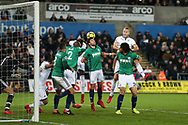 Mike van der Hoorn of Swansea city heads wide of goal from a corner. Premier league match, Swansea city v West Bromwich Albion at the Liberty Stadium in Swansea, South Wales on Saturday 9th December 2017.<br /> pic by  Andrew Orchard, Andrew Orchard sports photography.