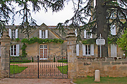 Vieux Chateau Certan and its court yard, black iron gate, stone wall and a white sign  Pomerol  Bordeaux Gironde Aquitaine France