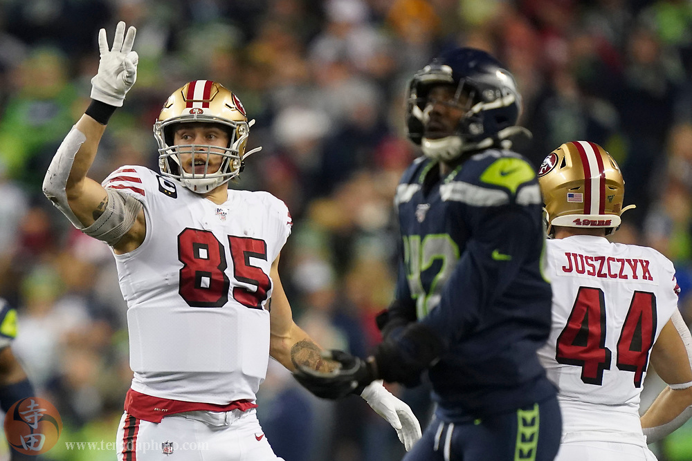 December 29, 2019; Seattle, Washington, USA; San Francisco 49ers tight end George Kittle (85) celebrates a second down against Seattle Seahawks defensive back Lano Hill (42) during the second quarter at CenturyLink Field.
