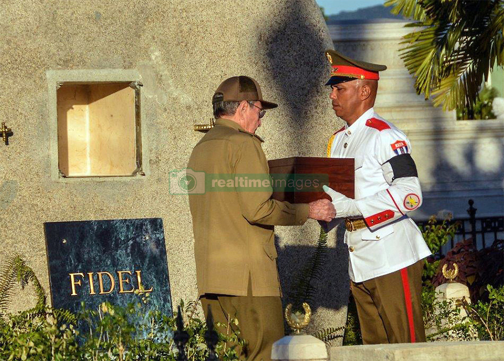 December 4, 2016 - Santiago, CUBA - Cuba's President Raul Castro receives the ashes of his older brother Fidel Castro from an honor guard before placing them into a niche in his tomb, a simple, grey, round stone about 15 feet high at the Santa Ifigenia cemetery in Santiago, Cuba, Sunday December 4, 2016. The niche was then covered by a plaque bearing the single name,''Fidel. (Credit Image: © Prensa Internacional via ZUMA Wire)