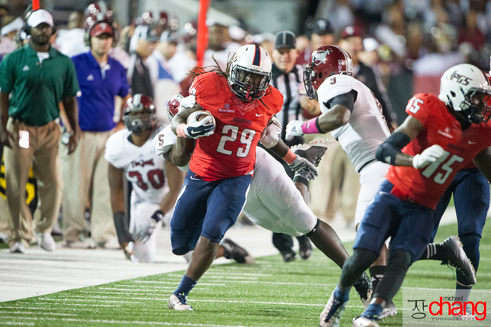 MOBILE, AL - OCTOBER 24: Running back Kendall Houston #29 of the South Alabama Jaguars attempts to escape a tackle by linebacker Sam Lebbie #5 of the Troy Trojans on October 24, 2014 at Ladd-Peebles Stadium in Mobile, Alabama.  The South Alabama Jaguars defeated the Troy Trojans 27-13. (Photo by Michael Chang/Getty Images) *** Local Caption *** Kendall Houston; Sam Lebbie