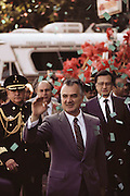 Mexican President Miguel de la Madrid Hurtado walking in a parade in Guadalajara, Mexico. Miguel de la Madrid Hurtado (born 1934) was elected president of Mexico in 1982.