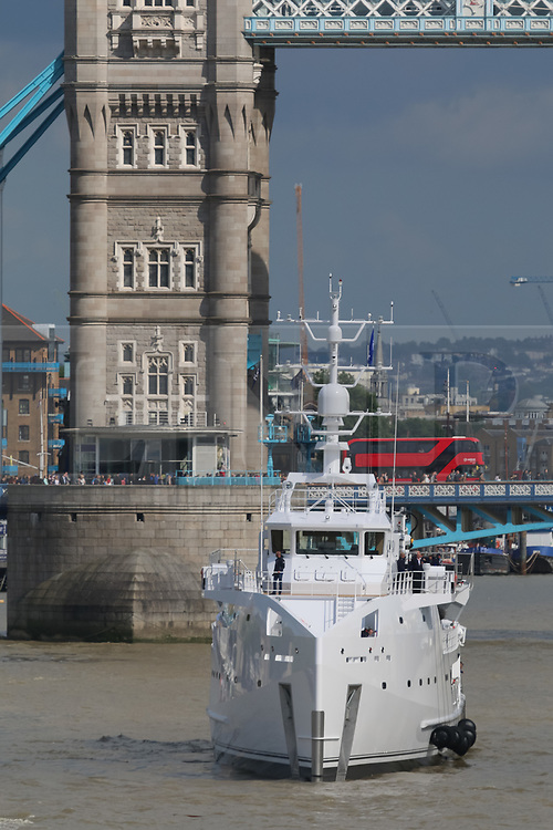 © Licensed to London News Pictures. 14/05/2017. LONDON, UK.  The Game Changer, a newly built superyacht support vessel arrives in London under Tower Bridge on the River Thames. The 70-meter superyacht support vessel has a large helideck so that yacht owners can take larger helicopters on long range flights to their mother yachts and 250 square metres of open deck space for tenders and toys, plus offices, facilities and accommodation for 22 crew and staff below deck. Built by Dutch Shipbuilder, Damen, the Game Changer was launched in March this year and recently completed sea trials in the North Sea.  Photo credit: Rob Powell/LNP