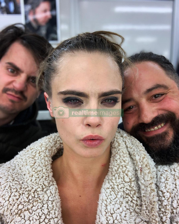 """Cara Delevingne releases a photo on Instagram with the following caption: """"Ouch!!! This is what the last day looks like!!! This show has taught me so much about who I am, my limits, my strengths, my sensitivity and also about how lucky I am to do what I love most in the world. Being able to explore humanity and why people do what they do. Most importantly, how none of this show or anything I do would be possible without the people around me! I will never stop thanking the cast and ESPECIALLY crew of #CarnivalRow they work harder than you could ever imagine. They are my family and always will be. I love you guys!!! Till next time.... #vignettestonemoss @amazonprimevideo @legendary @stillkingfilms"""". Photo Credit: Instagram *** No USA Distribution *** For Editorial Use Only *** Not to be Published in Books or Photo Books ***  Please note: Fees charged by the agency are for the agency's services only, and do not, nor are they intended to, convey to the user any ownership of Copyright or License in the material. The agency does not claim any ownership including but not limited to Copyright or License in the attached material. By publishing this material you expressly agree to indemnify and to hold the agency and its directors, shareholders and employees harmless from any loss, claims, damages, demands, expenses (including legal fees), or any causes of action or allegation against the agency arising out of or connected in any way with publication of the material."""