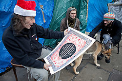 © Licensed to London News Pictures. 25/12/2011. London, U.K.. Christmas day at the occupy LSX, St. Pauls Churchyard 2011. The protesters cooking in the kitchen area and the turkey arriving donated and cooked by supporters of the cause..Photo credit : Rich Bowen/LNP