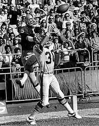 Oakland Raiders Fred Biletnikoff over  NewOrleans Saint #30..(1972 photo/Ron Riesterer)