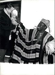 Mar. 14, 1962 - Chief Ben Oluwole, Viceroy of Legos: ...77years-old sovereign of the Yorubars (Yorubars), biggest unbder the 500 tribes of Nigeria, influetial judges of his country and father of 75 children, 14 of which are studying in London proved himself to be prety enterprising Old gelteman. Not only he insisted to fly personally as honorary guest of the Lufthansa new line Lagos-Hanburg, he also demonstrated that he knows all about European big-life. In any case, he was not to beat neither in the ''Twist'' nor in the Nigerian fashionable ''dance'' the ''High-Life''. and that with 77 years!. Photo shows in the picturesque costume of a sovereign of the Yorubar tribe, the Viceroy of Lagos, Chief Ben Oluwole (Chief Ben Oluwole) arrived to-day at the hamburg airport. The littler boy did not feel quite at his case, he was afraid of the ''bogey man' (Credit Image: © Keystone Press Agency/Keystone USA via ZUMAPRESS.com)