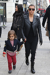 Kourtney Kardashian with her son Mason and friends are spotted spending a good time, leaving their Hotel, shopping on Champs Elysees Avenue and doing tourism bicycle in Paris, France on November 13, 2012. Photo by ABACAPRESS.COM  | 342014_024