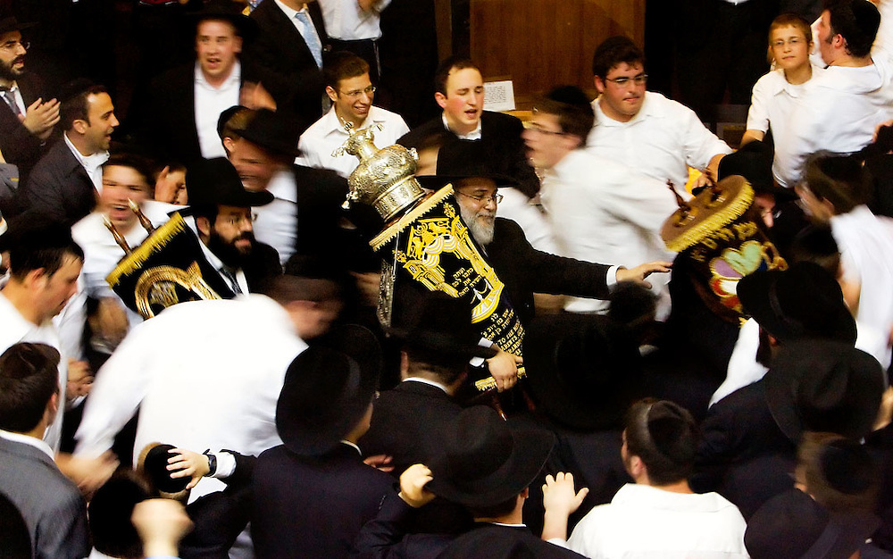 Waterbury, Conn.- 15 June 2008- Orthodox Jews circle around the Yeshiva Ateres Shmuel's new Torah scroll, center, and two existing borrowed scrolls at the conclusion of a procession from B'nai Shalom Synagogue to Yeshiva on Cooke Street...Josalee Thrift Photo
