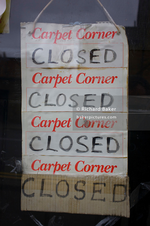 The repetition of a sign hanging in a shop's window in south London.