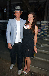 GILES DEACON and KATIE GRAND at a party to celebrate Stephen Jones's 25 Years of Millinery held at Debenham House, 8 Addison Road, London W14 on 13th July 2006.<br /><br />NON EXCLUSIVE - WORLD RIGHTS