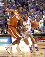 Kansas State guard Mario Taybron (R) drives against pressure from Texas guard Daniel Gibson (L), during the second half at Bramlage Coliseum in Manhattan, Kansas, February 22, 2006.  The 7th ranked Longhorns held on for a 65-64 win over K-State.