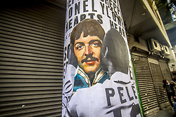 June 18, 2017 - Sao Paulo, Brazil - A wheat-paste piece of street art by artist Luis Bueno Shows soccer player Pelé kissing singer Paul McCartney. Today, June 18, one of the most charismatic and creative beatles, Paul McCartney, turns 75 years old. In October, the birthday party Beatle will perform in four Brazilian cities. It is his seventh passage through the country. Tickets to Porto Alegre and São Paulo are already sold out. Paul will also play in Belo Horizonte and Salvador. (Credit Image: © Cris Faga/NurPhoto via ZUMA Press)