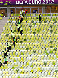 Workers cleaning the sits after the UEFA EURO 2012 group C match between Spain and Italy at The Arena Gdansk on June 10, 2012 in Gdansk, Poland.  (Photo by Vid Ponikvar / Sportida.com)