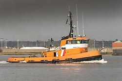Boss Tug steaming downriver on the River Thames.