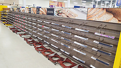 © Licensed to London News Pictures. 18/03/2020. Salford, UK. The Tesco branch , which normally opens until Midnight, closes two hours early as stock shortages become evident . A branch of Tesco in Salford has sold out of all stock of all bread products as customers panic buy essentials , including toilet paper, pasta and hand sanitiser , in fear of a lockdown and shortages . Today the British Government announced further measures to combat the spread of Coronavirus ( COVID-19 ) , including school closures and further state support for those affected . Photo credit: Joel Goodman/LNP