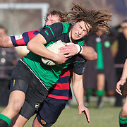 Michael Lamont of Alexandra is tackled by Aidan Winter of Arrowtown during the Arrowtown V Alexandra Rugby match at Jack Reid Park, Arrowtown, South Island, New Zealand, 25th June 2011
