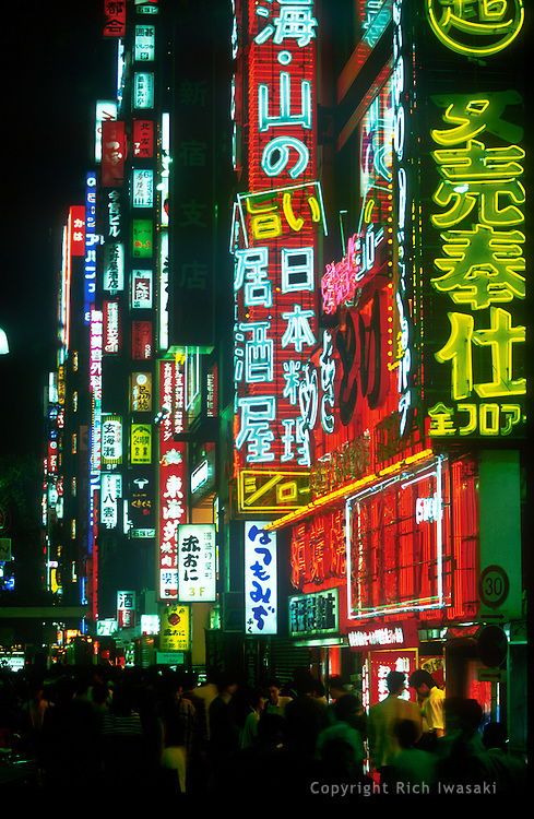 Neon signage and city street scene at night in the Ginza district, Tokyo, Japan