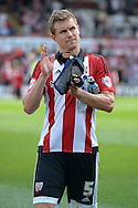 Andreas Bjelland of Brentford arrives  pitchside before k/o. Skybet football league Championship match, Brentford v Ipswich Town at Griffin Park in London on Saturday 8th August 2015.<br /> pic by John Patrick Fletcher, Andrew Orchard sports photography.