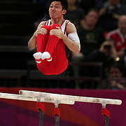 Kazuhito Tanaka, Japan, in action in the Men's Parallel Bars Final at North Greenwich Arena during the London 2012 Olympic games London, UK. 7th August 2012. Photo Tim Clayton