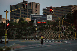 JOHANNESBURG, April 11, 2020  Photo taken on April 10, 2020 shows a man crossing an empty street in Johannesburg, South Africa..  South African President Cyril Ramaphosa on Thursday announced that the country's lockdown aimed at stemming the spread of COVID-19 would be extended for another two weeks. (Photo by YeshielXinhua) (Credit Image: © Xinhua via ZUMA Wire)